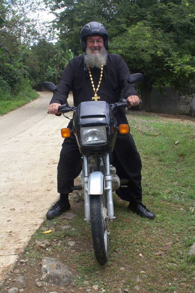 Father Silouan on motorcycle
